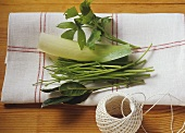 Herbs and leek for bouquet garni with kitchen string