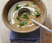 Green spelt soup in a wooden bowl