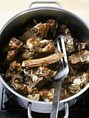 Fried veal bones in a pan, to make veal stock