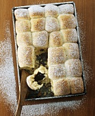 Buchteln (yeast dumplings) with powidl (stewed plums) on baking tray