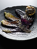 Grilled aubergine slices and garlic bulb with pesto