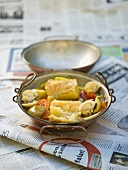 Cataplana (Portuguese fish stew) on newspapers