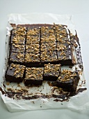 Chocolate tray-bake, cut into squares, on baking parchment