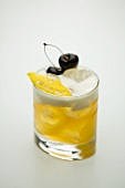 A lemon cocktail with cherries