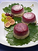 Grape and fig mousse on fig leaves