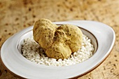 A white Alba truffle on risotto rice