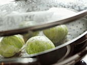 Savoy cabbage leaves stuffed with goose liver in a steamer