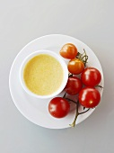 Vine tomatoes with a small bowl of dip
