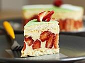 Piece of strawberry sponge cake with vanilla cream & marzipan