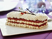 Layered meringue cake filled with fruit puree