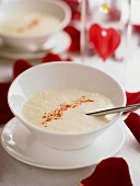 Cream of potato soup with rose petals