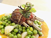 Fried lamb chop parcels with herbs on peas