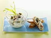 Toasted baguette and mayonnaise with herbs and capers