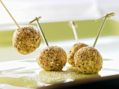 Balls of fresh goat's cheese with sesame seeds