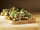 Toasted sesame bread topped with aubergine salad