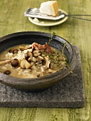 Mushroom soup with rice, bacon and Parmesan