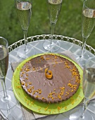 Orange chocolate cheesecake with biscuit base, glasses of wine
