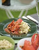 Lobster in tomato sauce with rice and peas