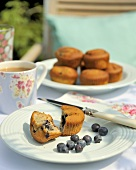 Blueberry muffin with tea for breakfast