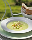 Cold minted pea soup with spring onions out of doors