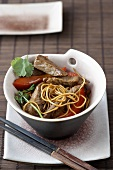 Asian noodles with peppers, beef and coriander