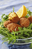Fish and chorizo croquettes on rocket
