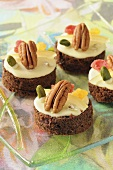 Four small chocolate cakes with nuts and dried fruit