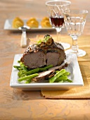 Leg of lamb studded with anchovies and garlic, green beans
