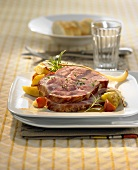 Roast cured pork with vegetables and herbs