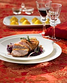 Duck breast with red wine shallot sauce on red cabbage