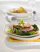 Roast cured pork with honey & orange crust on savoy cabbage
