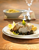 Roast monkfish with olive sauce