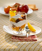 Fruit salad with red wine figs & caramel cream in a glass
