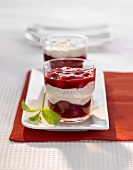 Poppy seed cream with cherries in two glasses