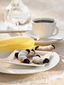Chocolate-dipped vanilla crescents and a cup of coffee