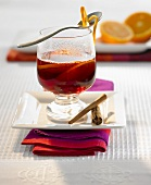 A glass of Christmas punch with orange slices