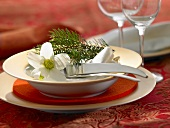 Christmas place-setting with spruce twig & flowers