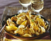 Braised chicken with onions, olives and lemons