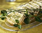 Cucumber terrine, sliced, on a glass platter
