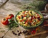 Pasta salad with ham, capers, olives, tomatoes, mozzarella