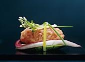 Salmon rice with chive flower, cress, radicchio, avocado