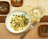 Gnocchi in white wine sauce with pumpkin seeds