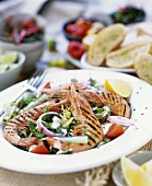 Grilled prawns on mixed salad with herb dressing