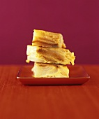 Three pieces of pear cake, stacked