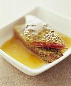Tuna with spice crust in honey sauce