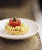 Leek and cheese spread, tomato and caper on crostino