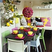 Colourful laid table with bowl of salad & floral decoration