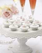 Mini-cupcakes with rose water on a cake stand