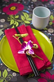 An Asian place-setting with an orchid