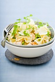 Pasta salad with chicken breast, peas, Parmesan & sesame seeds